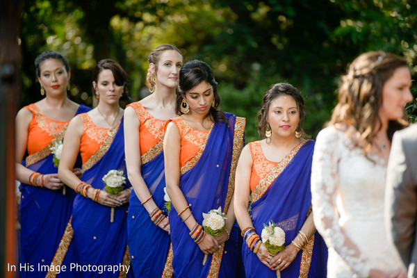 Royal blue and orange saris for bridesmaids.