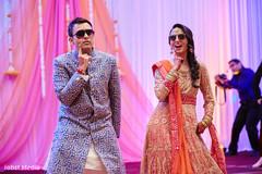 Bride and groom dancing during sangeet