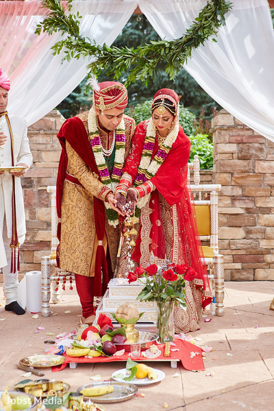 indian wedding ceremony floral and decor,indian groom outfit,indian bride fashion