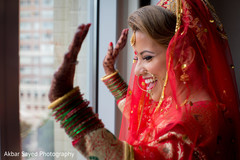 Lovely indian bride looking out the window