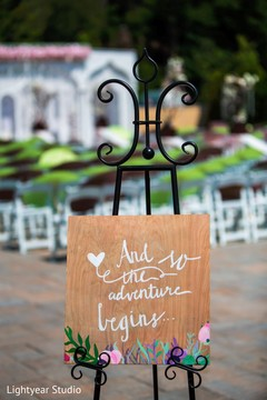 indian wedding ceremony,floral and decor,wedding sign