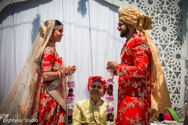 indian wedding ceremony,hindu wedding ritual,floral garlands