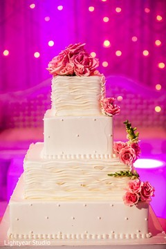 indian wedding reception,floral and decor,planning and design,wedding cake