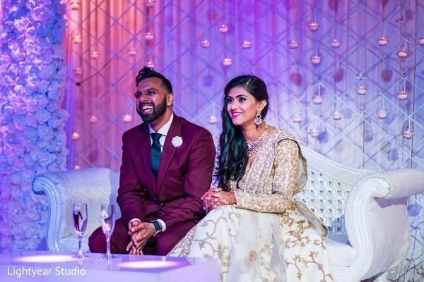 Newly wedded couple enjoying their wedding reception.