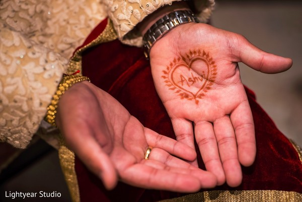 Romantic Indian groom mehndi.