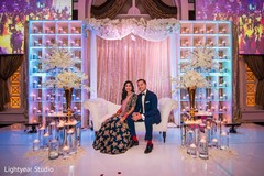 indian wedding reception,sweetheart stage,indian bride and groom,floral and decor