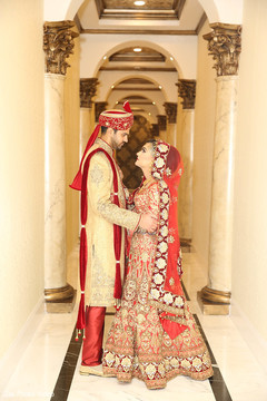 Gorgeous indian couple in their wedding outfits