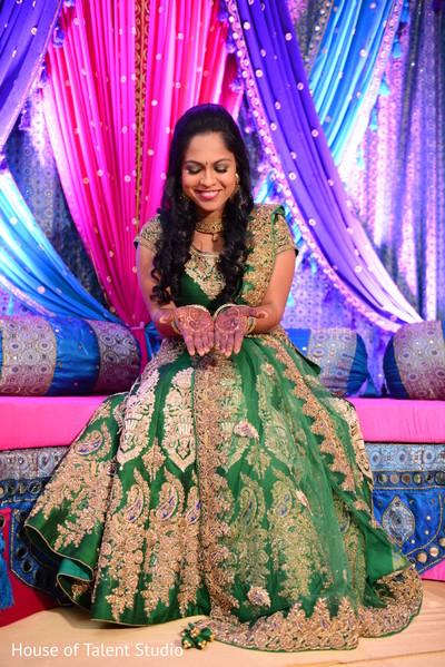 Gorgeous indian bride showing bridal mehndi art