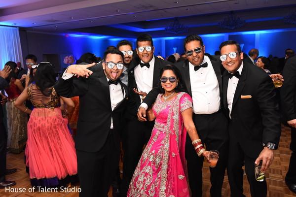 Indian bride and groom posing with groomsmen