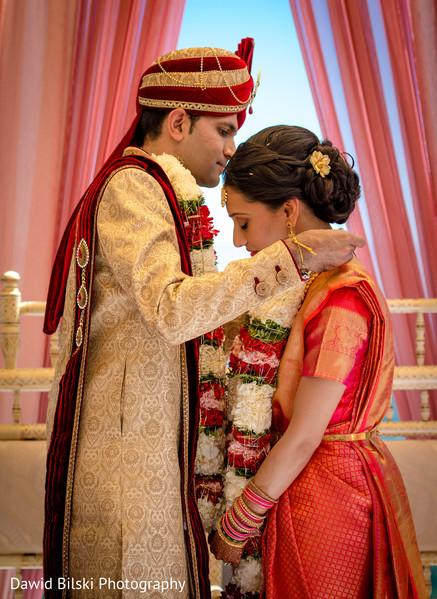 indian wedding ceremony,indian groom fashion,indian bride fashion,jai mala ceremony