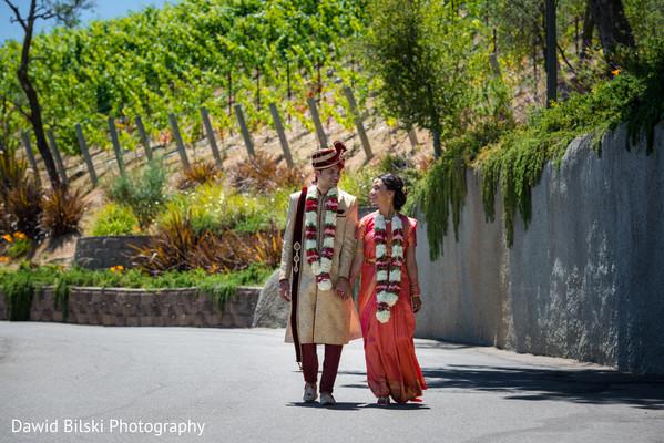 Beautiful indian couple walking holding hands