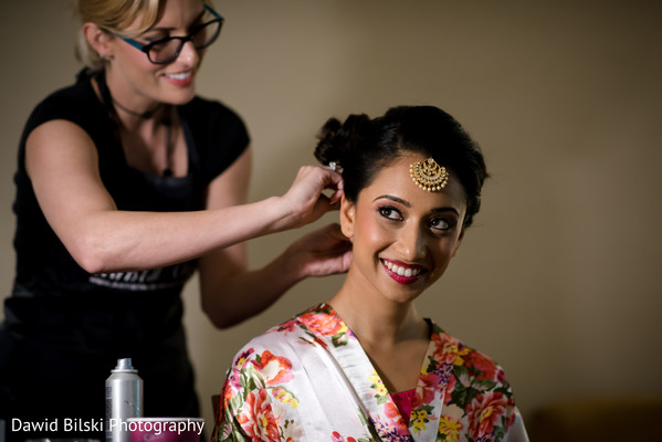 Lovely bride getting her hair done