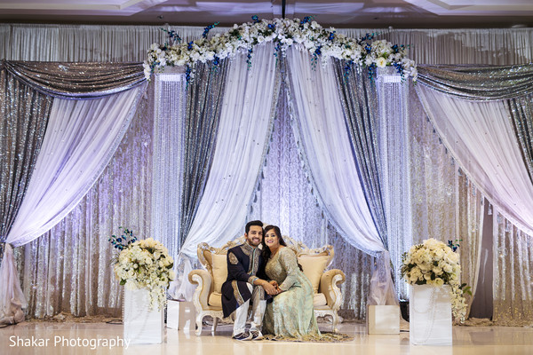 indian bride and groom,indian wedding reception,reception station,indian wedding reception floral and decor