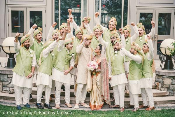 Indian lovebirds with groomsmen.