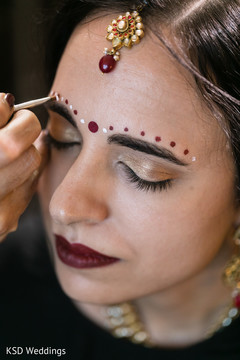 indian bridal makeup,indian bride getting ready,indian bride