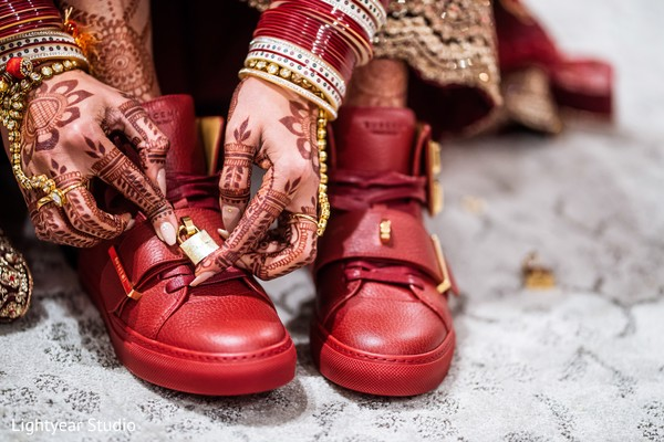 Unique Indian bridal red tennis shoes.