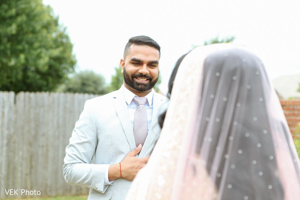 Indian groom admiring bride