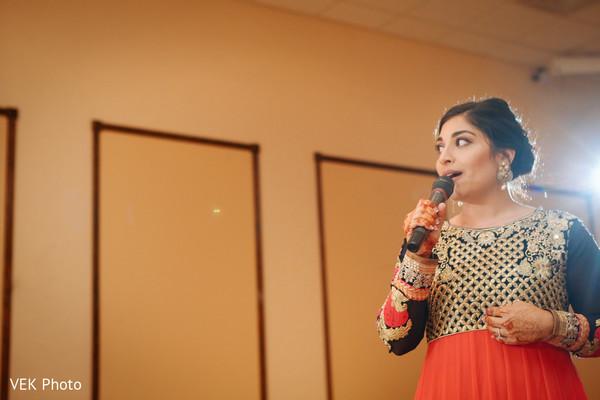 indian wedding guest giving a speech