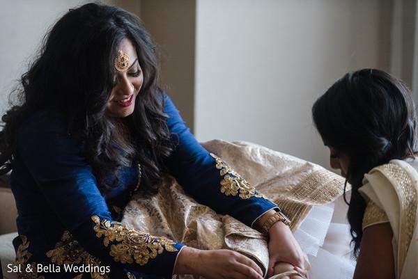 Indian bride putting on her heels