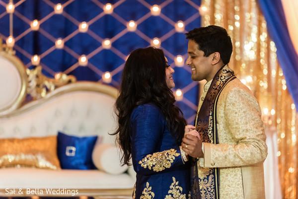 Sweet indian bride and groom in the dance floor