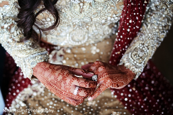 Glamorous bridal rings and mehndi.