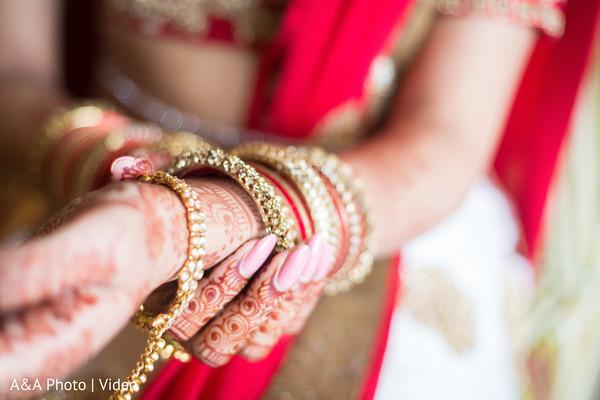 Indian bride putting bridal bangles on