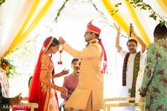 indian wedding ceremony,indian wedding ceremony photography,indian brides and groom,jai mala ceremony