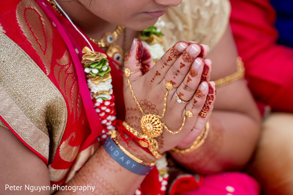 Indian girl hands with mehndi art close up