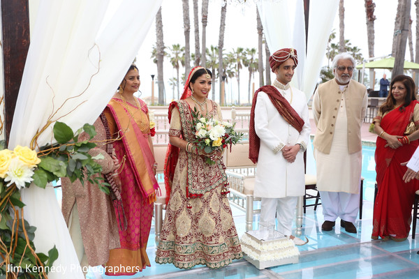 Indian wedding ceremony over the pool.
