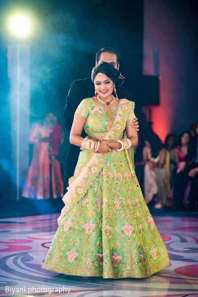 Gorgeous indian bride and groom dancing
