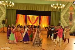 pre-wedding celebration,garba,choreography,indian bride and groom