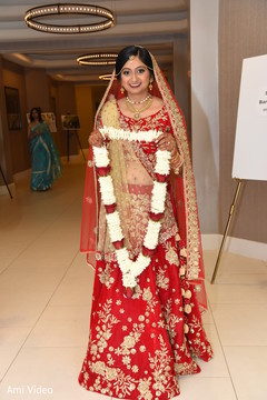 indian bride,bridal lehenga,flower garland
