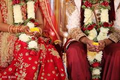 indian wedding ceremony,flower garlands,wedding ceremony fashion