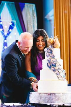 indian wedding cake,cutting the cake,tier cake