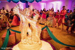 sangeet,indian bride and groom,pre-wedding celebrations,floral an decor