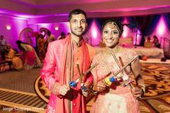 sangeet,indian bride and groom,dandiya sticks