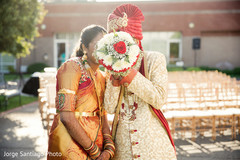 indian bride and groom,bridal bouquet,indian wedding photography