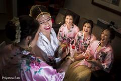 Joyful indian bride with bridesmaids
