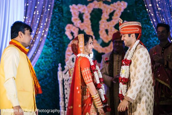 indian bride and groom,indian wedding ceremony,flower garlands
