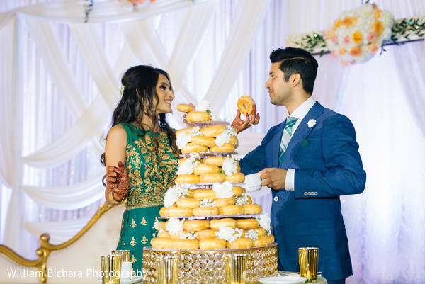 indian wedding reception,donut wedding cake,indian bride and groom