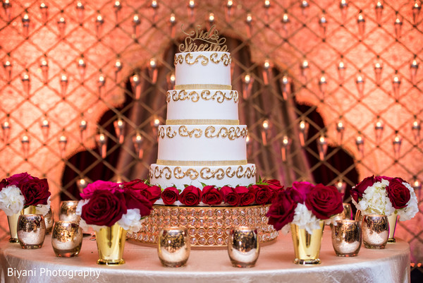 indian wedding reception,wedding cake,floral and decor