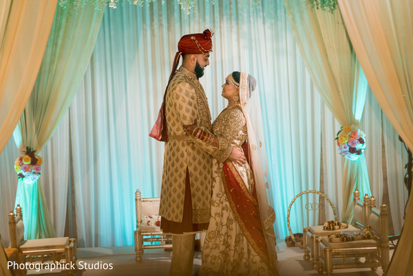 Sophisticated Indian bride and groom outfits. in Pentagon City, VA Indian Wedding by Photographick Studios