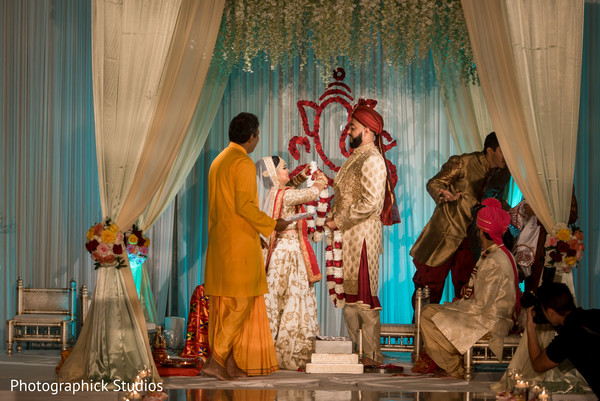 indian wedding ceremony,indian bride and groom,jaimala,mandap
