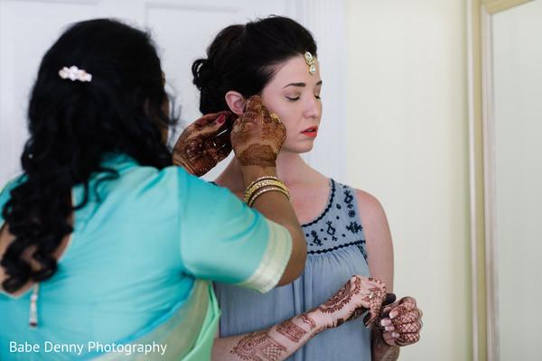 Indian bride preparing her wedding look.