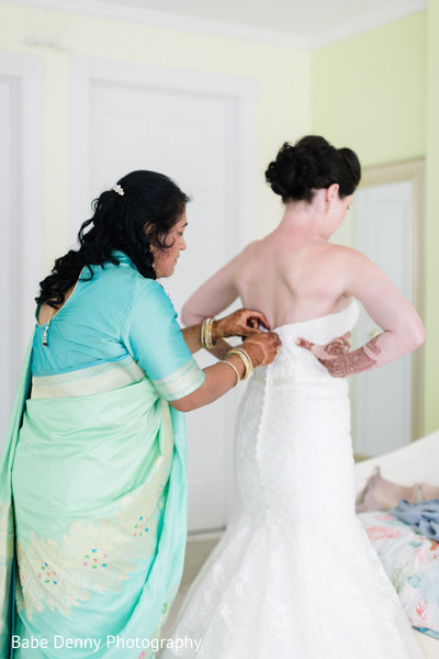 Maharani preparing her white wedding look. in Key Largo, FL South Asian Fusion Wedding by Babe Denny Photography