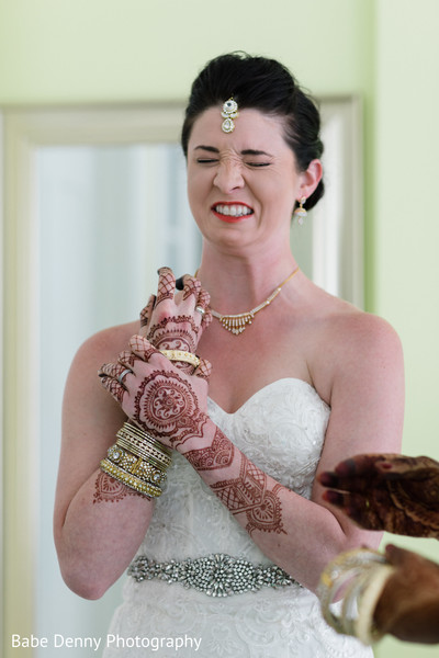 Indian bride candid shot. in Key Largo, FL South Asian Fusion Wedding by Babe Denny Photography