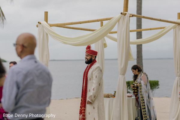 Indian groom waiting for her lovely bride. in Key Largo, FL South Asian Fusion Wedding by Babe Denny Photography