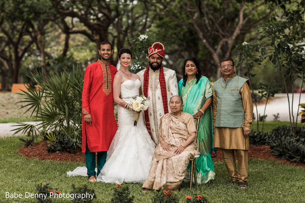 Indian fusion wedding family portrait. in Key Largo, FL South Asian Fusion Wedding by Babe Denny Photography