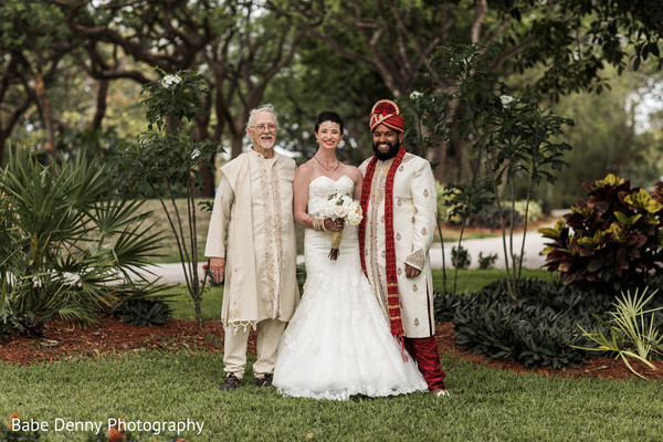 Indian bride and groom with the  father of the bride. in Key Largo, FL South Asian Fusion Wedding by Babe Denny Photography