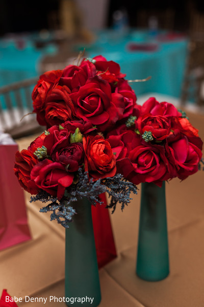Inspiring red Indian wedding floral centerpieces. in Key Largo, FL South Asian Fusion Wedding by Babe Denny Photography